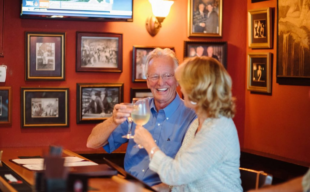 A couple enjoys the Westlawn's intimate bar