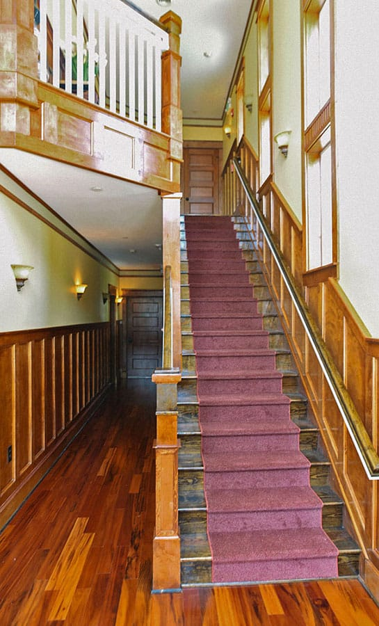 Elegant staircase showing custom woodwork